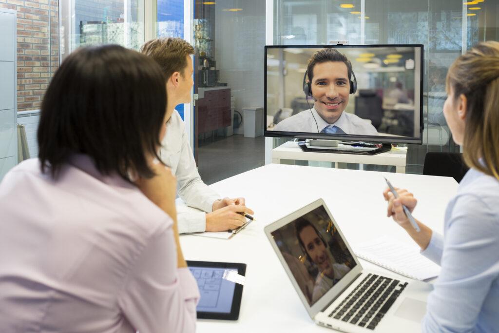 Businesswoman businessman desk chat colleagues